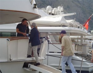 McCain boarding the yacht of convicted swindler Raffaello Follieri