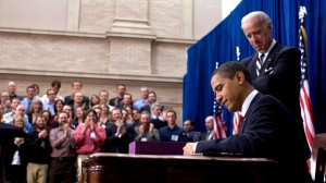 President Barack Obama signs the Stimulus Bill into law on February 17,  2009 in Denver, Colorado.