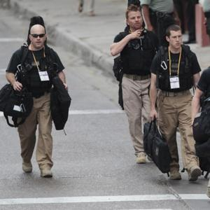 Secret Service Agents in Columbia. With their uniforms and badges, how secret can they be?
