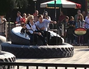 Romney at DisneyLand riding on Luigi's Magic Tires