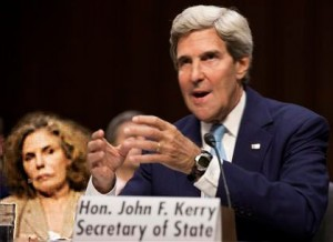 As Kerry with an nutty look proposes boots on the ground, his wife wonders
