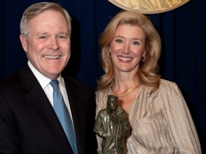 Secretary of the Navy Ray Mabus with wife Lynn laughing all the way to the bank?